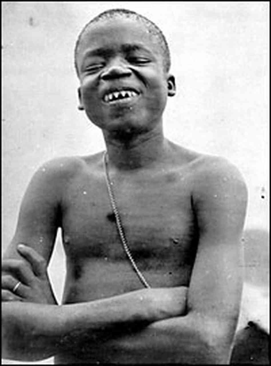 "Ota Benga (circa 1883 – March 20, 1916) was a Congolese man, an Mbuti pygmy known for being featured in an anthropology exhibit at the Louisiana Purchase Exposition in St. Louis, Missouri in 1904, and in a controversial human zoo exhibit in 1906 at the Bronx Zoo. Benga had been freed from African slave traders by the missionary Samuel Phillips Verner, a businessman recruiting Africans for the Exposition. He traveled with Verner to the United States. At the Bronx Zoo, Benga had free run of the grounds before and after he was ""exhibited"" in the zoo's Monkey House. [Image and description courtesy of Wikipedia]"